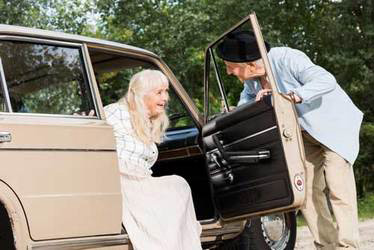 man-helping-woman-out-of-car